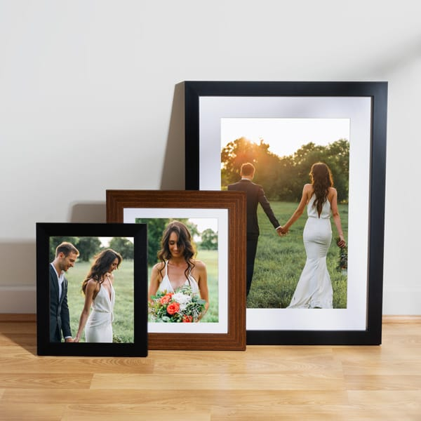 Wedding photo print ideas - photo frames leaning against a wall